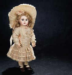 """Beautiful French Bisque Bebe E.J. with Fine Antique Costume  19"""" (48 cm.) Bisque socket head,blue/grey glass paperweight inset eyes,dark eyeliner,lushly-painted lashes,brush-stroked and multi-feathered brows,accented eye corners,shaded nostrils,closed mouth with defined space between the outlined lips,pierced ears,blonde mohair wig over cork pate,French composition and wooden fully-jointed body."""