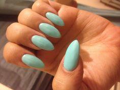 Tiffany's blue stiletto almond nails