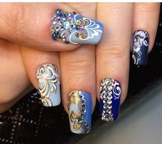 This is very beautiful and unusual manicure. The amazing monogram and unusual shapes which remind a decorations from the carnival in Rio are well settled o