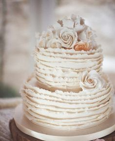 Love these ruffles so much, ivory would look elegant with a b & w photo on top. Or fresh flowers.
