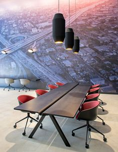 The Delta pendants designed by RBW illuminate the boardroom table at the HQ for Beats by Dre office