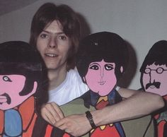 "inthebeatleslife: "" David Bowie (probably around 1968) with cartoons of The Beatles, used for their movie ""Yellow Submarine"" """