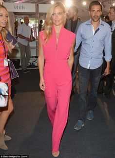 #partywear #streetstyle | Bar Refaeli in a hot pink jumpsuit paired with a yellow clutch and metallic evening sandals