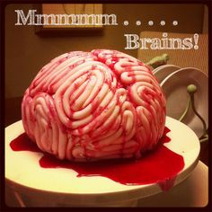 Such a cool cake idea! 2 cakes (she used red velvet) on eachother and shaped in a brainshape. Then roll fondant in long coils and place them on the cake making sure you have two seperate halfs. Then make blood sauce: 1 cup Corn Syrup  1-2 tbsp coco powder  red food coloring