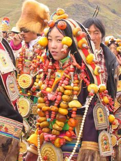 Dabpa, Kham, Tibet. Local tibetan girl dressed up in authentic local traditional costume at a horse. These costumes and their constituent ornaments are family heirlooms