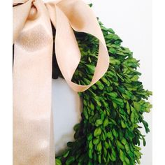Boxwood wreath from Target tied with a gold satin ribbon. Abby M. Interiors