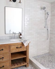 The perfect tile combination in this bathroom designed by using CYou can find White subway tiles and more on our website.The perfect tile. White Subway Tile Bathroom, Subway Tile Showers, Subway Tiles, Mosaic Bathroom Floor Tile, Subway Tile Bathrooms, Modern Bathroom Tile, Concrete Bathroom, White Bathrooms, Luxury Bathrooms