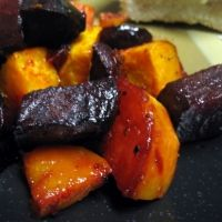 Roasted Sweet Potatoes And Beets Recipe - I'm thinking adding a little bit of crumbled bacon to this sounds absolutely amazing