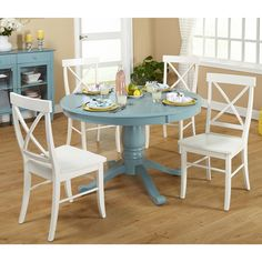 The Arianna Dining Set has a country-cottage charm that features a pedestal base round table complimented by four X-back chairs. Sturdily constructed of durable rubberwood and MDF, this set will seat your family for years to come.
