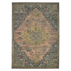 Artful applications of color and pattern make the Vintage Rug from Threshold look like a classic, well-loved piece. This hand-tufted area rug in warm colors has a weathered appearance.