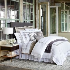 Created exclusively for Bloomingdale's in a classic palette of black, white and grey, the Sferra Argento collection features detailed scroll embroidery framing the duvet and shams. The duvet is finish