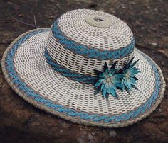 Blue lotus flower black ash and sweetgrass hat made by Mohawk basket maker, Ann Mitchell.