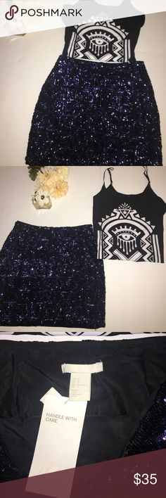 H&M Sequin Mini Skirt w/ Evil Eye Blouse Cami NWT H&M Sequin Square Design Mini Skirt | paired and sold included with evil eye Blouse cami | both pieces have never been worn || skirt size: 2 || top size: Medium H&M Other