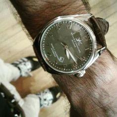 Green dial, crocodile grain