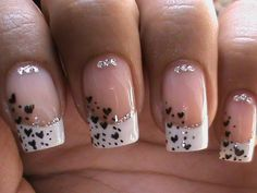 Cute Nail Art with a white French tip, tiny little black hearts and lovely glitter!