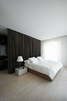 How To Create Dreamy Bedrooms Using Bed curtains bedroom – curtains divide space (see rest of home) – good idea for boys room – maybe [. Apartment Room, Apartment Design, Home Bedroom, Bedroom Interior, Home Decor, Closet Behind Bed, Minimalist Bedroom, Curtains Behind Bed, Bed Curtains