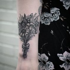 pretty black and grey bouquet tattoo