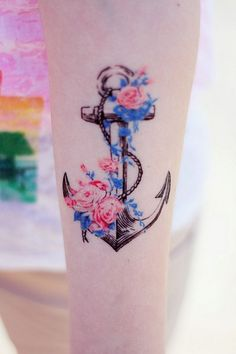 I love the contrast between the sharp black lines of the anchor with the soft colorful lines of the flowers. Beautiful