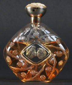 Lalique Crystal Perfume Bottle with Contents. Signed.