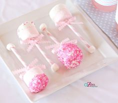 Adorable marshmallow pop rattles at a Gender Reveal Baby Shower #babyshower #genderreveal by laurie