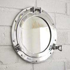 A lightly brushed aluminium porthole mirror. Now includes Free Delivery