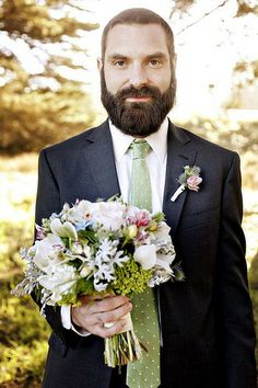 Groom + bouquet = adorable Love this idea for a pic. And this guy's beard is SO mighty!