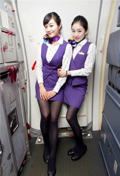 They are wearing purple and make-even-tiny-super-long-and-sexy black leggings. Any shade of blue is awesome, but pure purple. Nylons, In Pantyhose, Air Hostess Uniform, Stewardess Costume, Airline Cabin Crew, Flight Pilot, Fly Around The World, Airline Uniforms, Wearing Purple