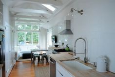 Simple narrow kitchen, clean lined narrow house kitchen, white kitchen, high ceiling kitchen with skylights