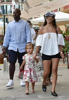 Family fun: The 37-year-old wore an off-the-shoulder top with black bike shorts