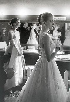 Grace Kelly and Audrey Hepburn backstage at the 28th Academy Awards