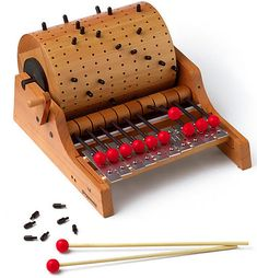 Designed by Herbert Bahli in 1983 for Naef Toys, Switzerland, the Gloggomobil is probably the most stunning and educational music toy ever created. Your child can create his or her own music by moving the studs on the barrel.