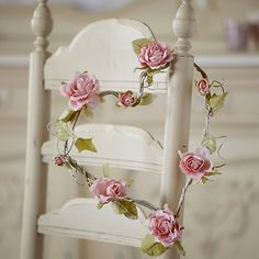 Beautifully made paper rose flower heart hanging from ribbon. Would look lovely in your boudoir and makes a pretty wedding decoration.