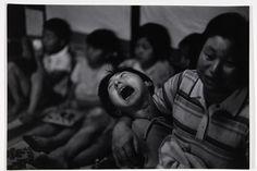 Tomoko Uemura in her mother's arms, Minamata, Japan, c. 1972-75