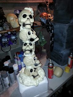 Dollar tree skulls....great stuff foam filler.....stryofoam cooler....simple and painless..lol.....created by John cortese.....N.Y.C