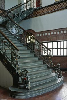 There is a sense of grandeur with this stair case, but perhaps shooting less stairs would have been better - the top of the photo is tightly cropped making the stairs look short of the mark and creating a low ceiling.