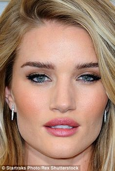 ROSIE HUNTINGTON-WHITELEY: The fish-gape comes easily to the M&S model, whose parted lips accentuate her cheekbones. With a come-hither stare, too, it looks well-rehearsed.