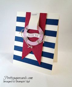 Ahoy matey! Love the life preserver made with circle punches and some linen thread!