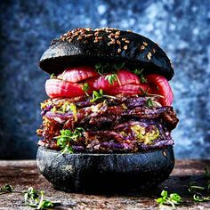 """Roasted purple potato and brussels sprouts burger with pickled red onion and garden…"""""""