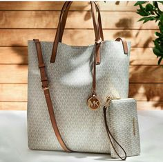 a8426579860a Shop designer handbags and accessories at The Logo Shop on the official  Michael Kors site.