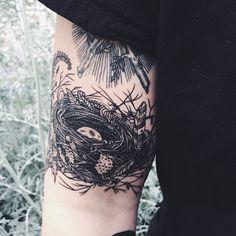 Nest tattoo