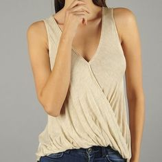 Oatmeal wrap top  Burnout style sleeveless top featuring a wrapped neckline and bubble hem. Slightly longer in the back. Perfect to wear a bandeau with.  Can be dressed up with a blazer or wear casual with shorts!  2nd pic is actual top Available in S,M,L. Model is a size 4 and wearing a small.                                                    Measurements on S: L-24, B-30, W-32.                  Please do not purchase this listing, comment below for a personal listing! Price firm unless…