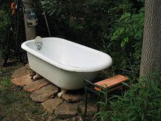 Recycled claw-foot tub as an outdoor soaking tub.