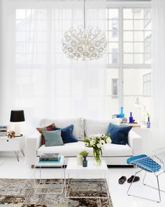 Sheer Verticals keep this room modern and bright! Absolutely Love the light fixture and pops of color!