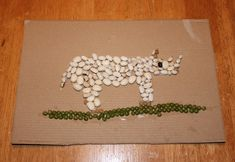 A very fine rhinoceros mosaic made using dried beans.   from http://frugalfun4boys.com