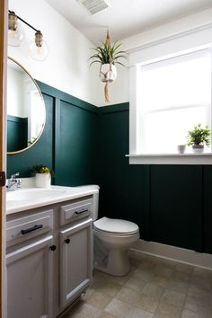 Modern Green Bathroom Makeover Check out the DIY board and batten in this small bathroom! Wow I love how she added that trim and painted the walls dark green. Such a pretty modern bathroom design! Master Bathroom Layout, Modern Master Bathroom, Downstairs Bathroom, Diy Bathroom Decor, Modern Bathroom Design, Bathroom Interior Design, Home Interior, Bathroom Ideas, Interior Colors