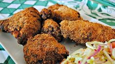 """Baked Devils' Chicken  """"This is a crispy, spicy baked chicken that can be served hot, but like traditional fried chicken, I think it's best room temperature or cold the next day. This chicken is addictive and wonderful for picnics and potlucks."""" – Rachel ray"""