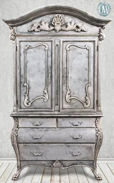 Stunning wardrobe transformed by Annie Sloan Stockist Rachelle Fleming of Originally Worn in Macon, MO | Chalk Paint® by Annie Sloan in layers of Graphite, Paris Grey, Old Ochre and Pure White. She also added a touch of Annie Sloan Gilding Wax and finished with Clear and Black Chalk Paint® Wax. What a beauty!