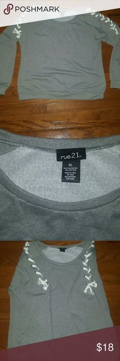 NWOT- Rue 21 Sweatshirt Top Bought but never worn. Great design of braided sleeves,very soft & warm.  From a pet and smoke-free home.  If you have any questions please comment below as I usually respond within 24hrs or less.  Thanks for looking & feel free to stop by my closet anytime as items are added weekly 💖 HAPPY POSHING!!!🌻🌻🌻 Rue21 Tops