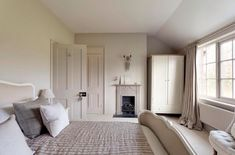 Different shades of cream, different texture Elephants Breath on the walls and woodwork and Charleston Grey on the fire place all by Farrow and Ball. Bedroom Loft, Home Bedroom, Master Bedroom, Bedroom Decor, Calm Bedroom, Bedroom Ideas, Cream Bedrooms, Guest Bedrooms, Cream And Grey Bedroom