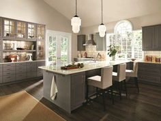 The soothing grey of LIDINGÖ cabinets provide a natural charm to this gloriously spacious kitchen